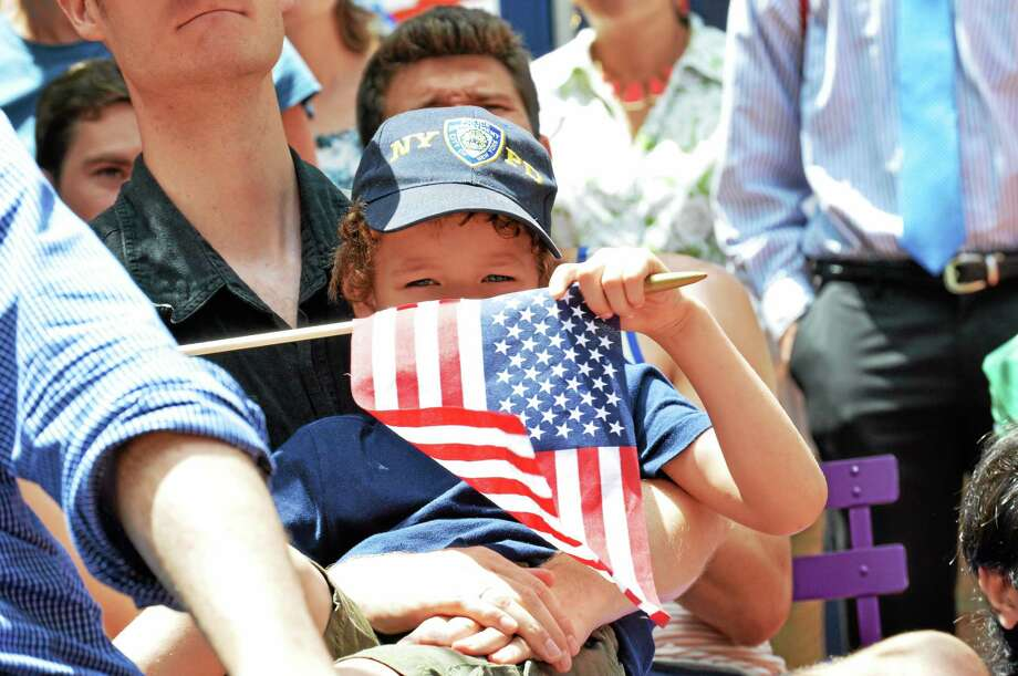 A young fan watches the United States vs. Germany game Thursday at Pitkin Plaza's World Cup Village in New Haven. Photo: Colin Kennedy — New Haven Register