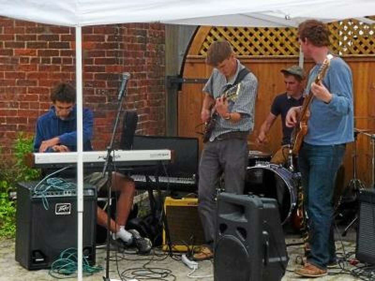 Ryan Flynn/Register Citizen - Local band Branchwater performed in Cobble Court.