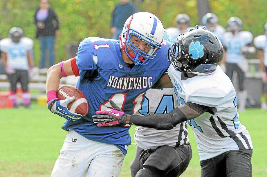 Nonnewaug's Jon Gombos rushes during the Chiefs 26-20 loss. Gombos rushed for 107-yards and two touchdowns. Photo: Laurie Gaboardi — Register Citizen