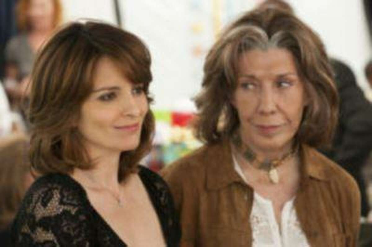 """This film image released by Focus Features shows Tina Fey, left, and Lily Tomlin in a scene from """"Admission."""" (AP Photo/Focus Features, David Lee)"""