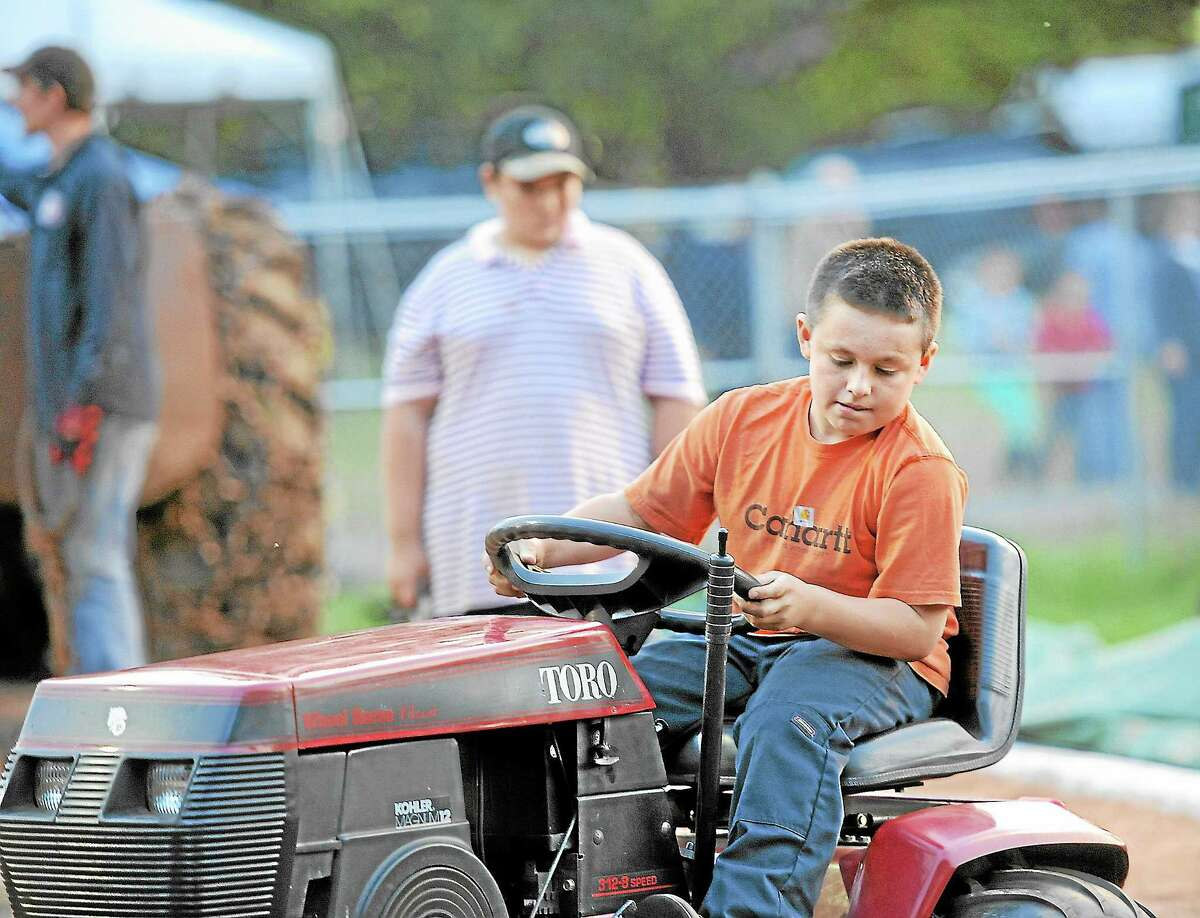Jack Lawlor, 10, takes part in the tractor pull competition at the Riverton Fair on Friday.Laurie Gaboardi - Register Citizen