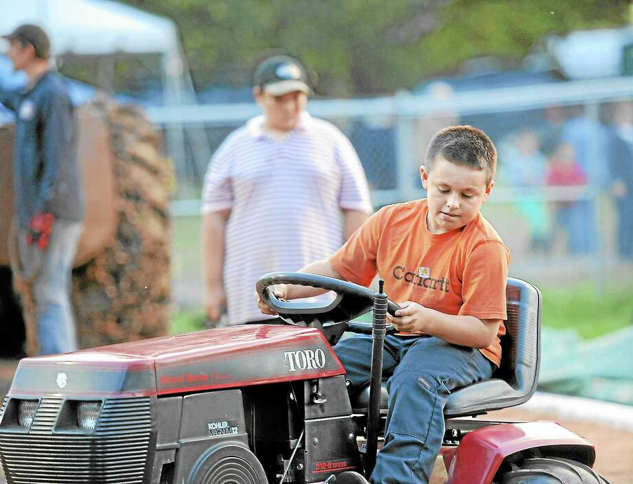Jack Lawlor, 10, takes part in the tractor pull competition at the Riverton Fair on Friday.Laurie Gaboardi - Register Citizen Photo: Journal Register Co.