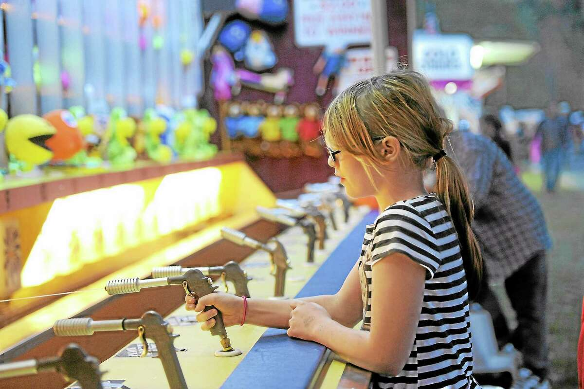 The Riverton Fair began Friday.Kate Stedman, 11, plays one of the fairway games.Laurie Gaboardi - Register Citizen