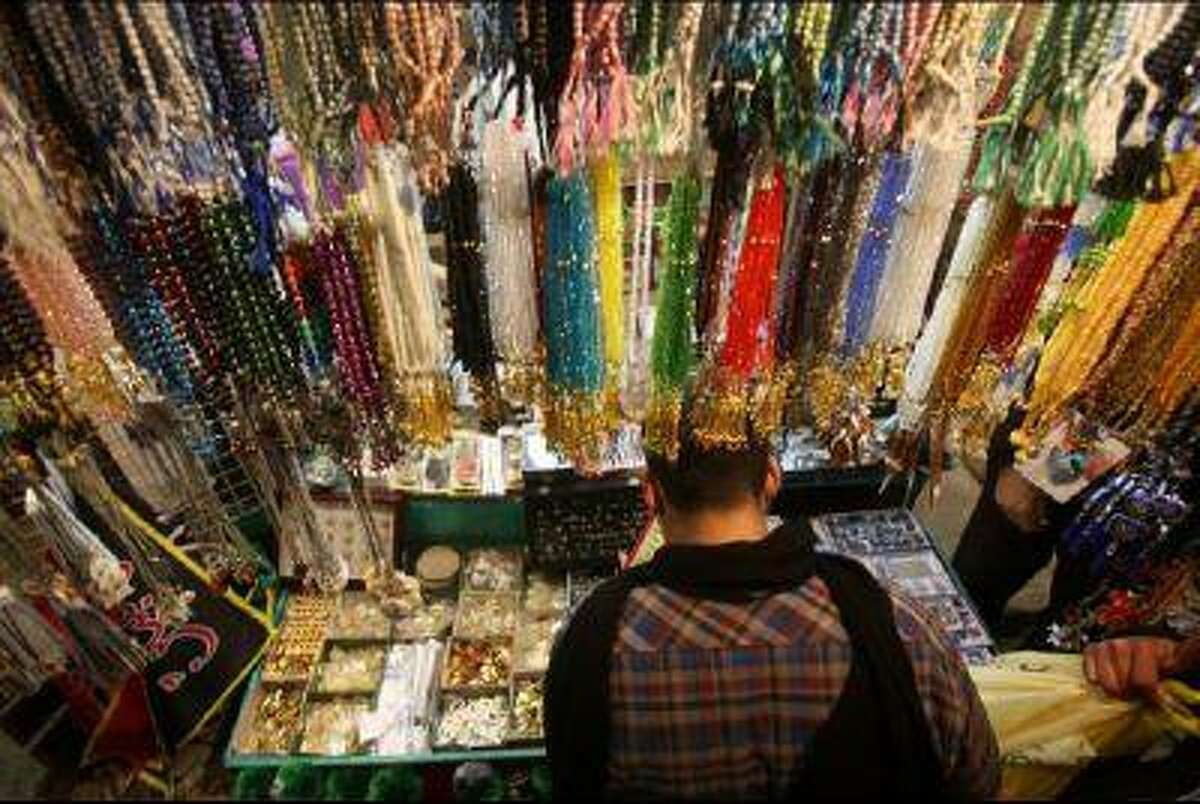 Prayers beads hang waiting to be sold as Shia Muslim pilgrims arrive to take part in a religious ritual in the shrine city of Karbala, southwest of Iraq's capital Baghdad, on Jan. 2. Agate-based jewelry and prayer beads have come under increased scrutiny as advocacy groups continue to push for more safety regulations in the production of these products.