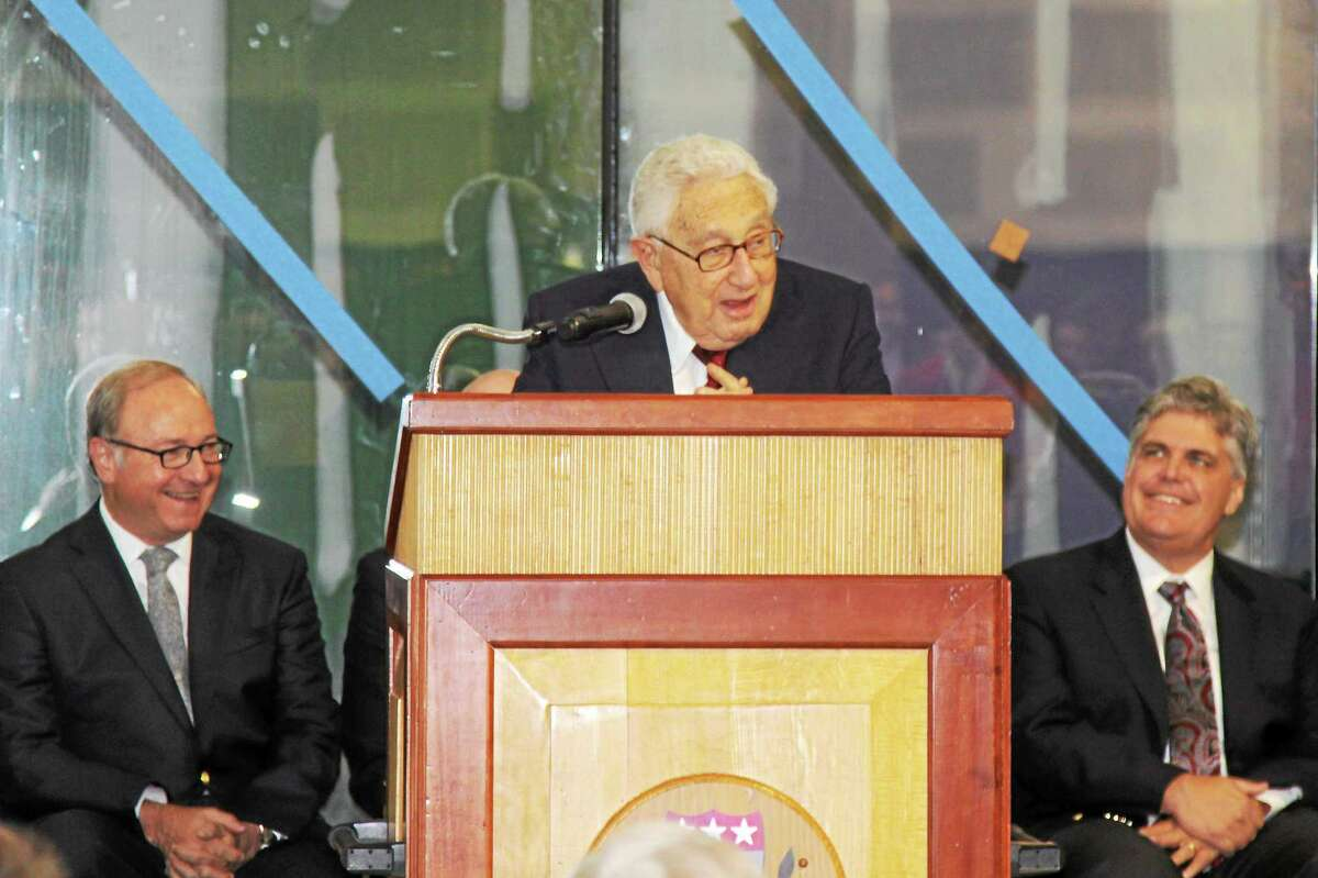 Diplomat and former Secretary of State Henry Kissinger speaks in Kent during the dedication of the Admiral James and Sybil Stockdale Ice Arena on Saturday.