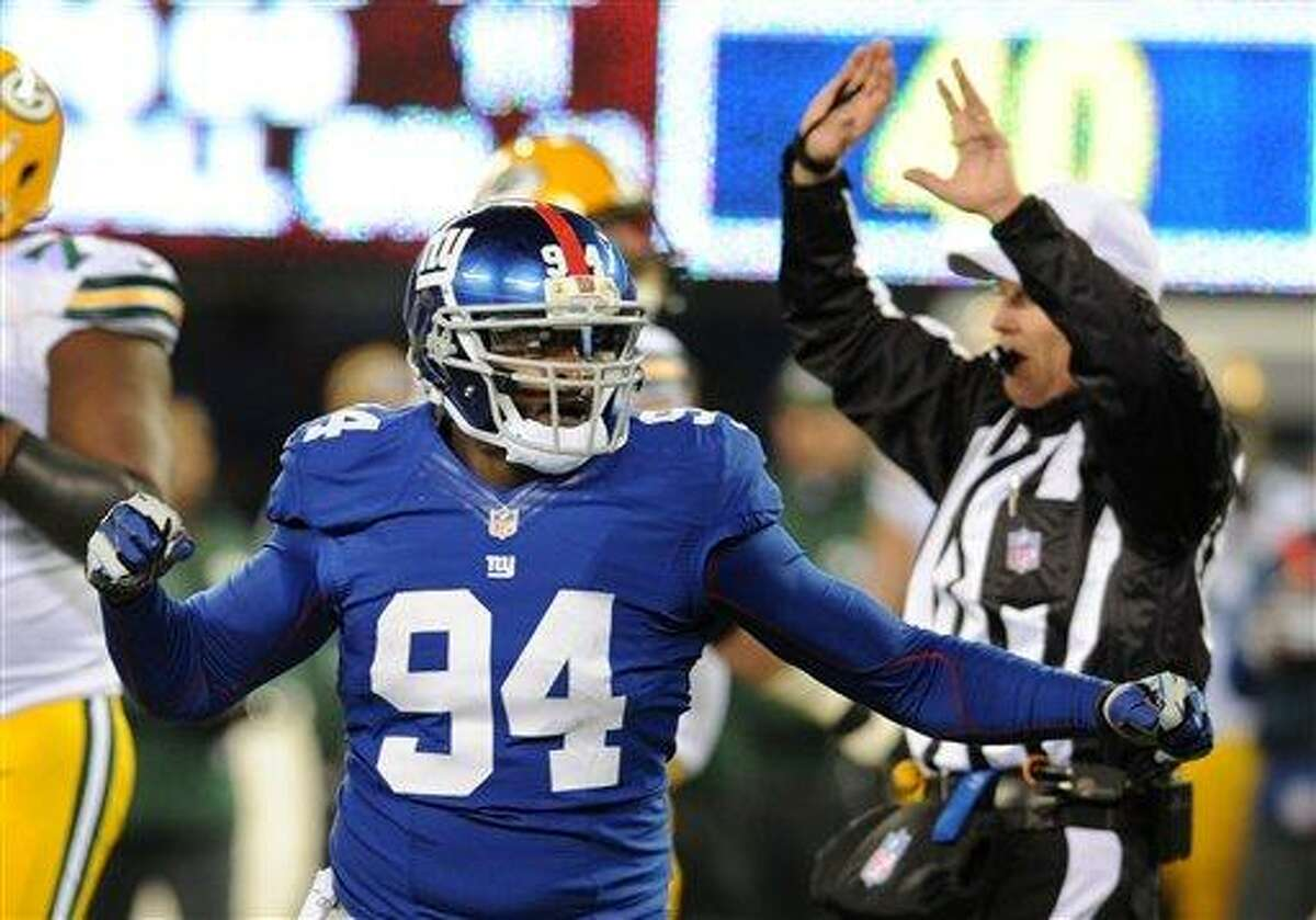 New York Giants linebacker Mathias Kiwanuka (94) celebrates a sack of Green Bay Packers' Aaron Rodgers during the second half of an NFL football game, Sunday, Nov. 25, 2012, in East Rutherford, N.J. (AP Photo/Bill Kostroun)