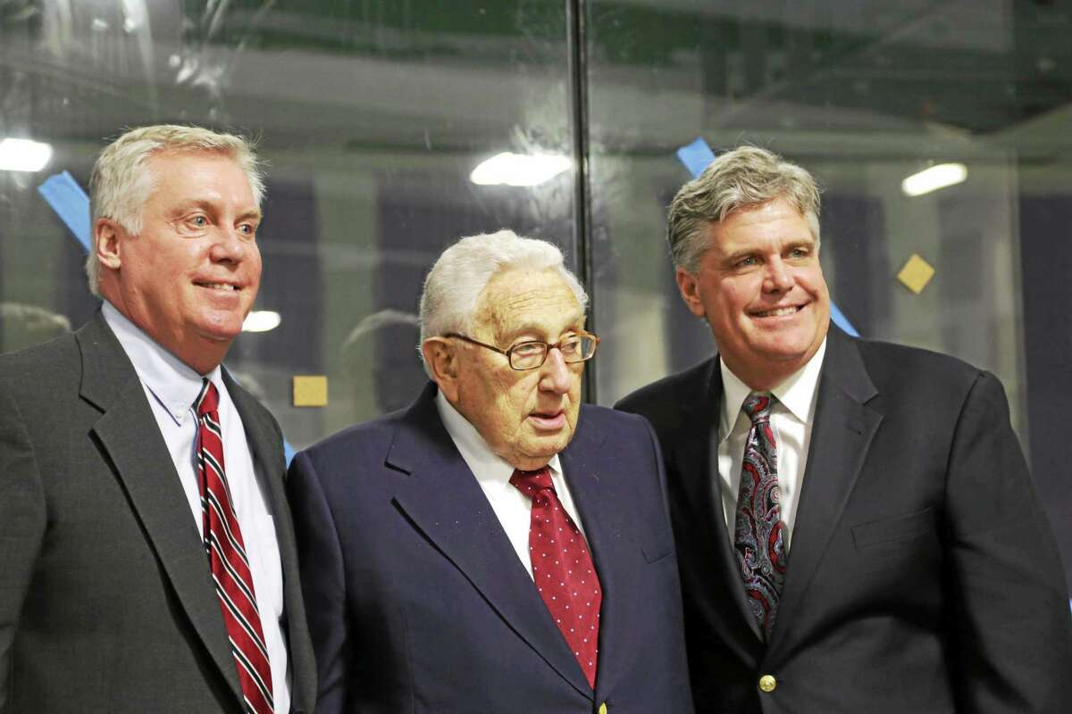Diplomat and former Secretary of State Henry Kissinger speaks in Kent during the dedication of the Admiral James and Sybil Stockdale Ice Arena on Saturday. Taylor and Sidney Stockdale also spoke.