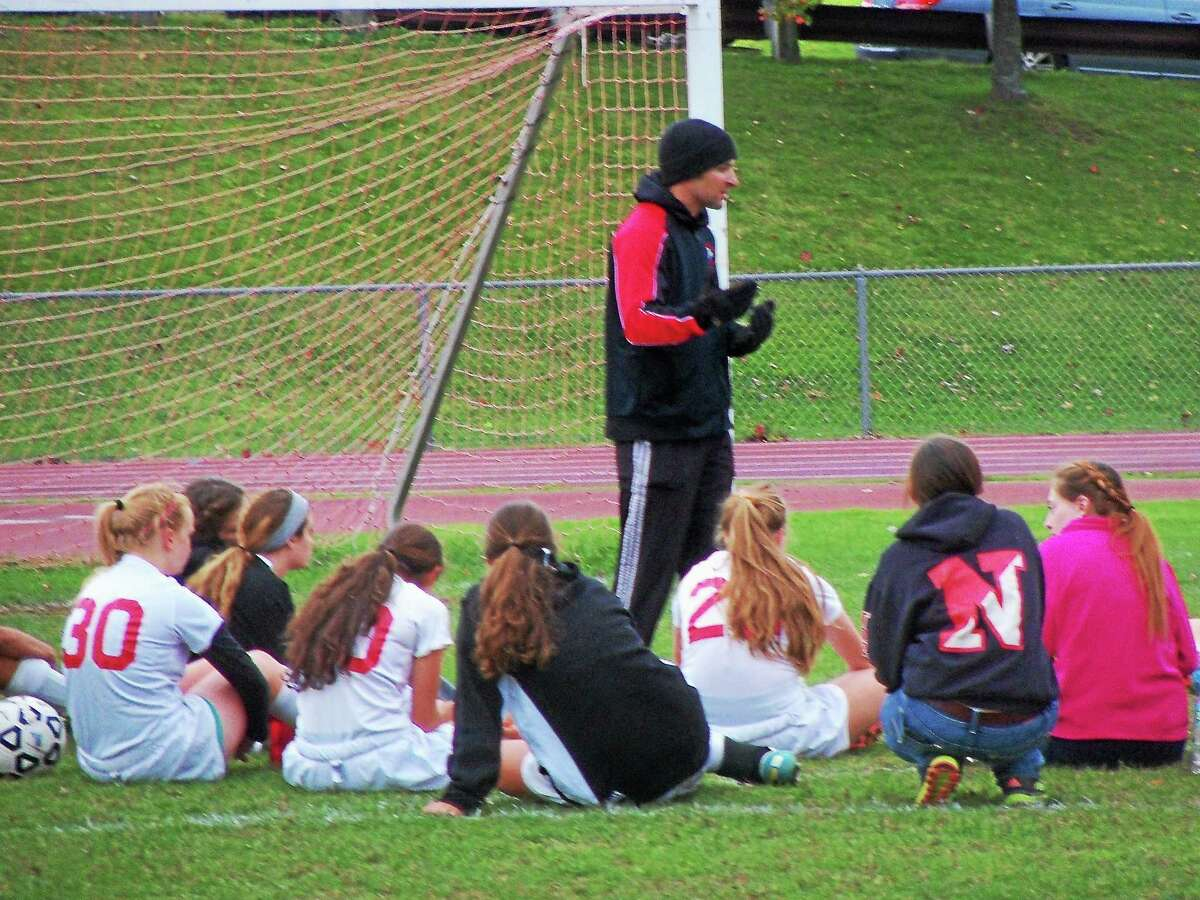 Northwestern coach Jared Stotler talks to his team during halftime against Housatonic.