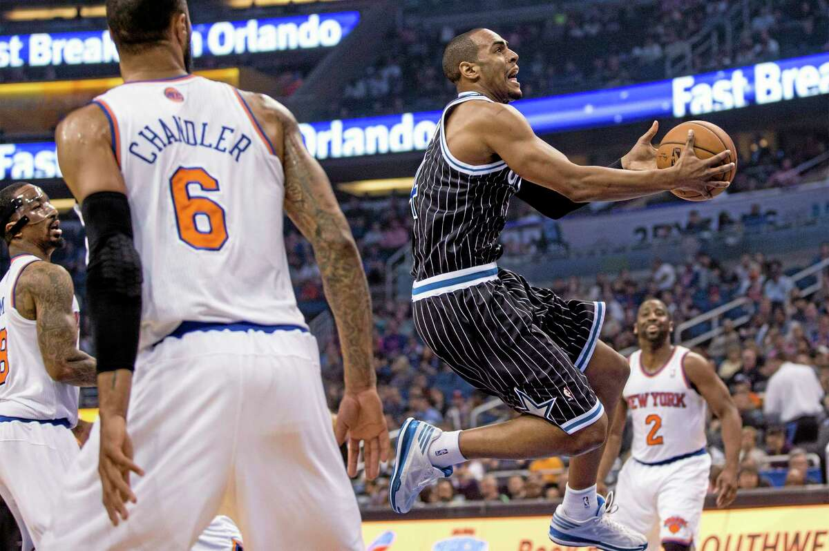The Orlando Magic's Arron Afflalo, center, drives to the basket while New York Knicks center Tyson Chandler (6) and Raymond Felton (2) look on during a Feb. 21 game in Orlando, Fla.