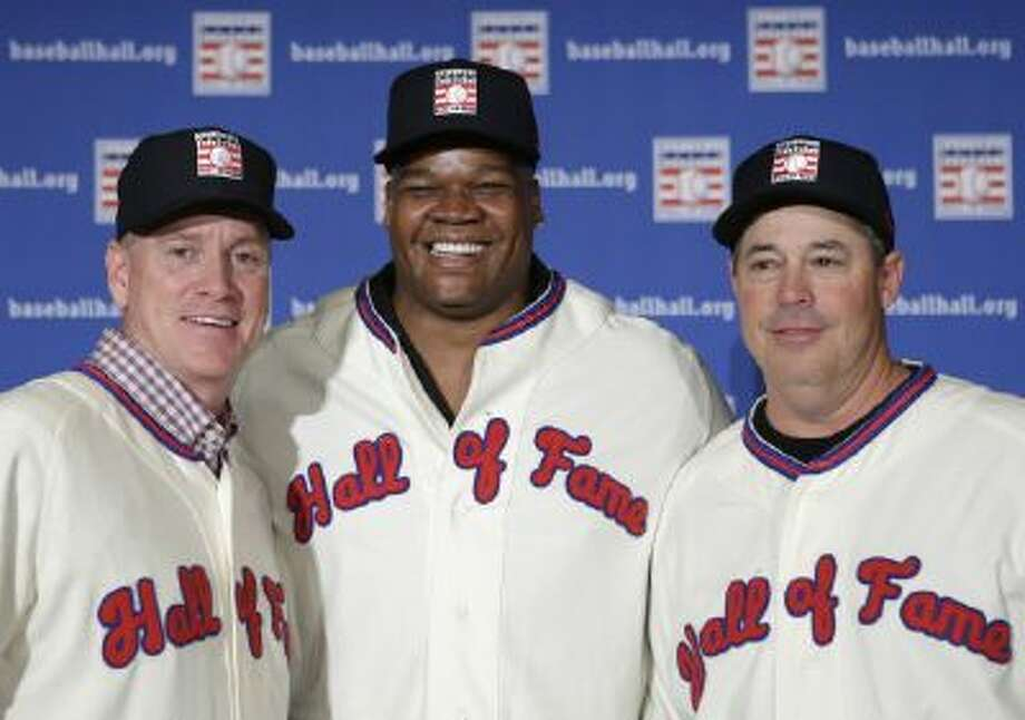 Former Atlanta Braves pitchers Tom Glavine, left and Greg Maddux, right, pose with Chicago White Sox slugger Frank Thomas after a press conference announcing their election to the 2014 Baseball Hall of Fame class, Thursday in New York.