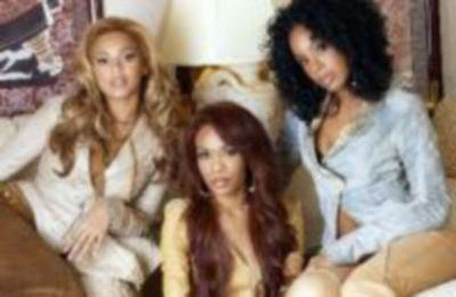 Music group Destiny's Child poses at the Rhigha Royal Hotel in New York, Nov. 16, 2004. From left are Beyonce Knowles, Michelle Williams and Kelly Rowland. (AP Photo/Jim Cooper)