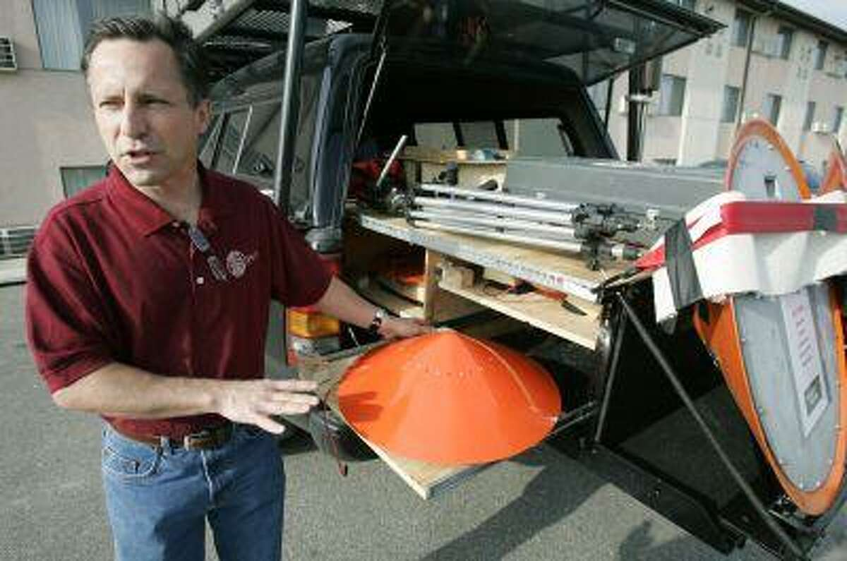 FILE - In this May 26, 2006, file photo Tornado chaser Tim Samaras shows the probes he uses when trying to collect data in Ames, Iowa. Jim Samaras said Sunday, June 2, 2013, that his brother Tim Samaras was killed along with Tim's son, Paul Samaras, and another chaser, Carl Young, on Friday, May 31, 2013 in Oklahoma City. The National Weather Service's Storm Prediction Center in Norman, Okla., said the men were involved in tornado research. (AP Photo/Charlie Neibergall, File)