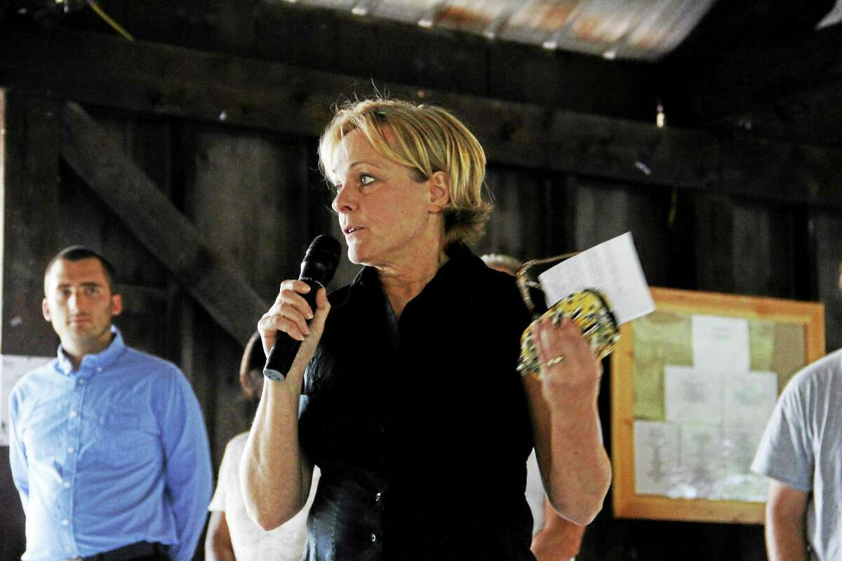 Mayor Elinor Carbone speaks to an audience at the Republican Town Committee's 48th annual Meet the Candidates barbecue fundraiser on Wednesday, Aug. 21, at Elks Pond.