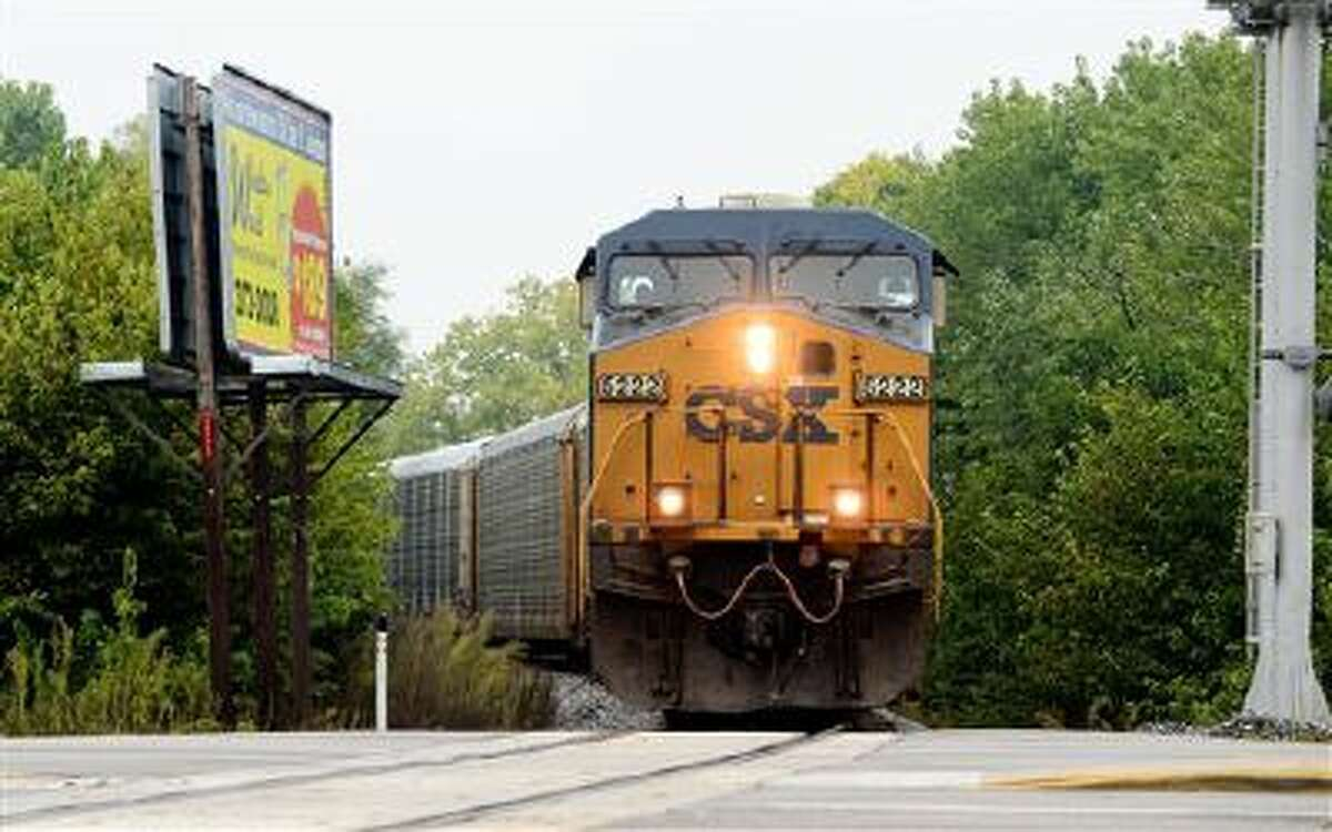 A train speeds through Columbus, Ind. in this Oct. 1 file photo.