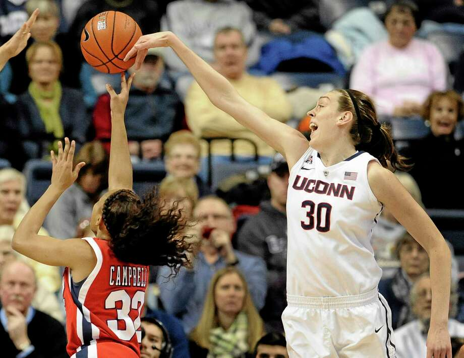 UConn's Breanna Stewart blocks a shot by Houston's Te'onna Campbell during the first half of the top-ranked Huskies' 90-40 win on Tuesday in Storrs. Photo: Jessica Hill — The Associated Press  / FR125654 AP