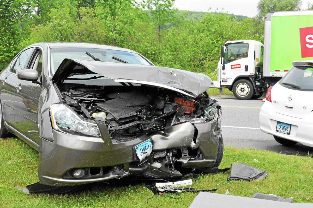 The damage to the Infiniti that caused Firefighters to think extrication might be necessary. The driver of this vehicle received a cut on his hand from this accident.