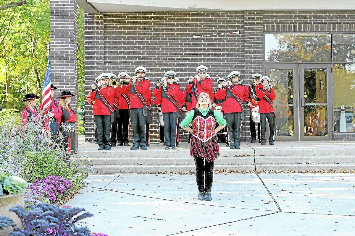The St. Peter's Drum Corps performs at the Torrington Columbus Day celebration on Saturday. The musical group was founded in the city in 1930 and now travels around the country and world performing.