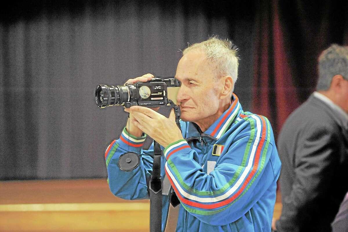 "Antonio Viscariello, of Torrington, films the ""Italian Mayor for a Day"" festivities at Coe Memorial Park on Saturday. Viscariello, who is originally from Italy, produces a weekly Italian television show locally."