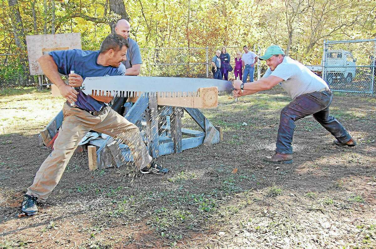 Jake Bederian and Rob Asseline participating in the Riverton Fair lumberjack contest on Saturday.