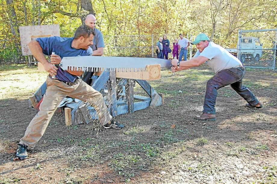 Jake Bederian and Rob Asseline participating in the Riverton Fair lumberjack contest on Saturday. Photo: Mercy Quaye — Register Citizen