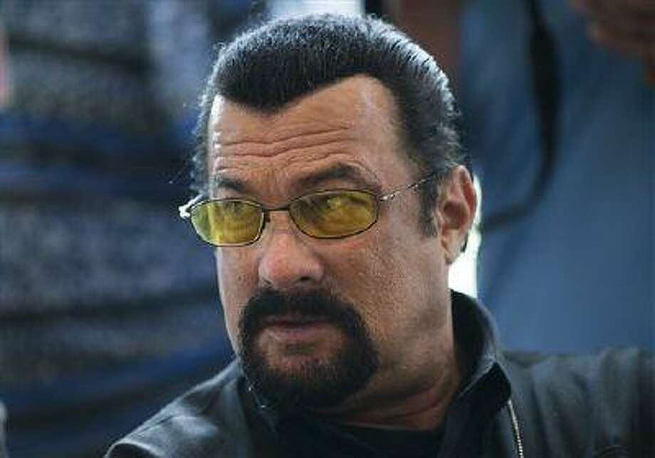 U.S. actor Steven Seagal waits for a news conference of U.S. congressional delegation to Russia in the U.S. embassy in Moscow, Russia, Sunday June 2, 2013. The head of a U.S. congressional delegation to Russia says it learned little about what could have been done to prevent the Boston Marathon bombings, despite the best efforts of actor Steven Seagal. Some meetings were set up by Seagal, who met Russian President Vladimir Putin in March. (AP Photo/Alexander Zemlianichenko) Photo: AP / AP