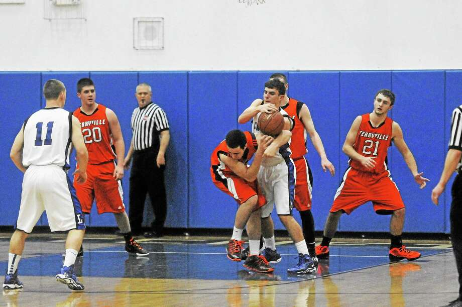 Players from Litchfield and Terryville battle for possession Wednesday night. Photo: Laurie Gaboardi — Register Citizen