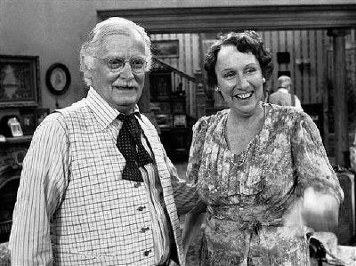 """FILE - Co-stars Art Carney, left, and Jean Stapleton stand together during a rehearsal for the play """"You Can't Take it With You"""" in Los Angeles on May 14, 1979. Stapleton has died at the age of 90. John Putch said Saturday, June 1, 2013 that his mother died Friday, May 31, 2013 of natural causes at her New York City home surrounded by friends and family. (AP Photo/Brich)"""