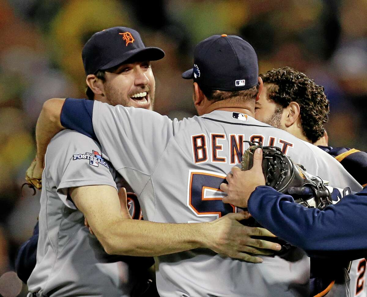 Detroit Tigers pitcher Joaquin Benoit (53) is congratulated by starting pitcher Justin Verlander, left, after the Tigers beat the Oakland Athletics 3-0 to win Game 5 of the American League division series.