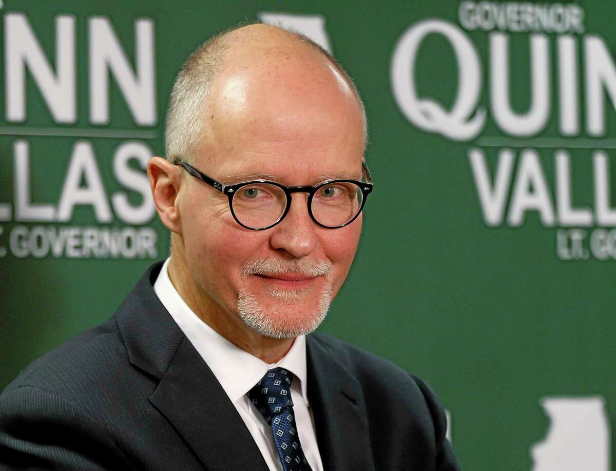 FILE - In this Nov. 12, 2013 file photo, Paul Vallas listens to reporter's questions after Illinois Gov. Pat Quinn introduced him as his choice for running mate during a news conference in Chicago. Vallas will continue working as school superintendent in Bridgeport, Conn., until March 1, 2014, just before Illinois' primary election. Vallas submitted his resignation to Bridgeport officials on Dec. 31 and is required to give a 60-day notice. He was the former Chicago schools CEO. (AP Photo/Andrew A. Nelles, File)