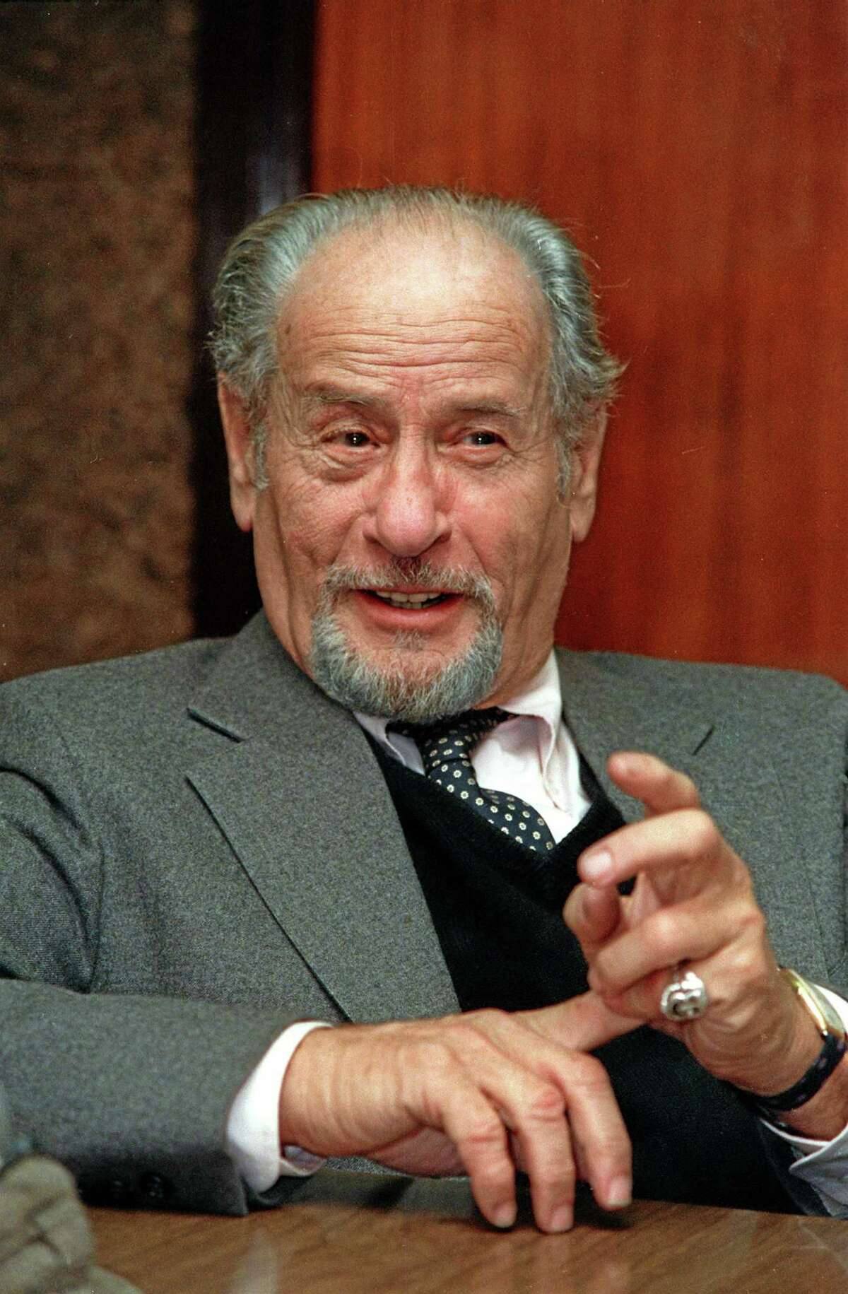 This Nov. 1987 file photo shows actor Eli Wallach speaking during an interview in New York. Wallach, the raspy-voiced character actor who starred in dozens of movies and Broadway plays over a remarkable and enduring career, died Monday, June 23, 2014 of natural causes. He was 98. (AP Photo/Marty Lederhandler, File)