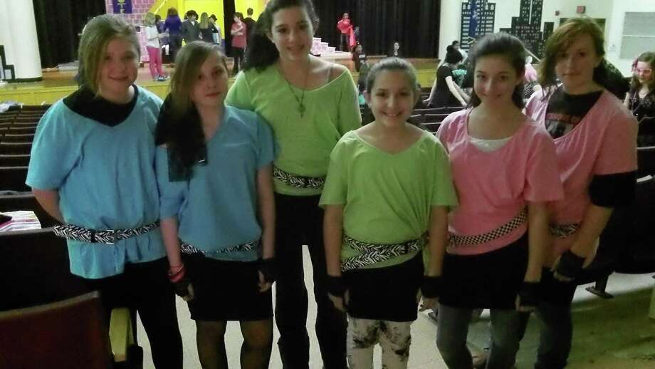 Submitted photo Members of the cast of Torrington Middle School's show on the music and times of the 1980s are ready to take the stage this weekend.