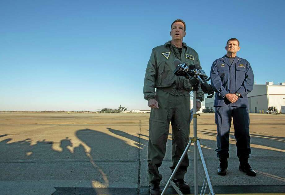 Navy Cmdr. Todd Flannery, left, Cmdr. Helicopter Sea Combat Wing Atlantic, and U.S. Coast Guard Capt. John K. Little, Sector Commander, as they answer questions about a crash of a Navy MH-53-E Sea Dragon helicopter into the Atlantic off Virginia Beach, Wednesday, Jan. 8, 2014, on the tarmac at the Norfolk Naval Station, Va. (AP Photo/The Virginian-Pilot, Bill Tiernan) MAGS OUT. Photo: AP / The Virginian-Pilot
