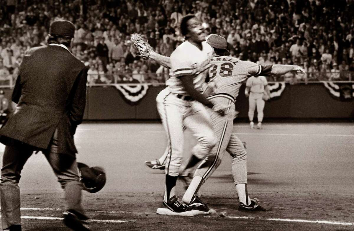 In this Oct. 26, 1985 file photo, umpire Don Denkinger, left, watches as Cardinals pitcher Todd Worrell, right, stretches to catch the ball as the Royals Jorge Orta steps on first base. Denkinger ruled Orta safe and the Royals went on to win the game and eventually the World Series.