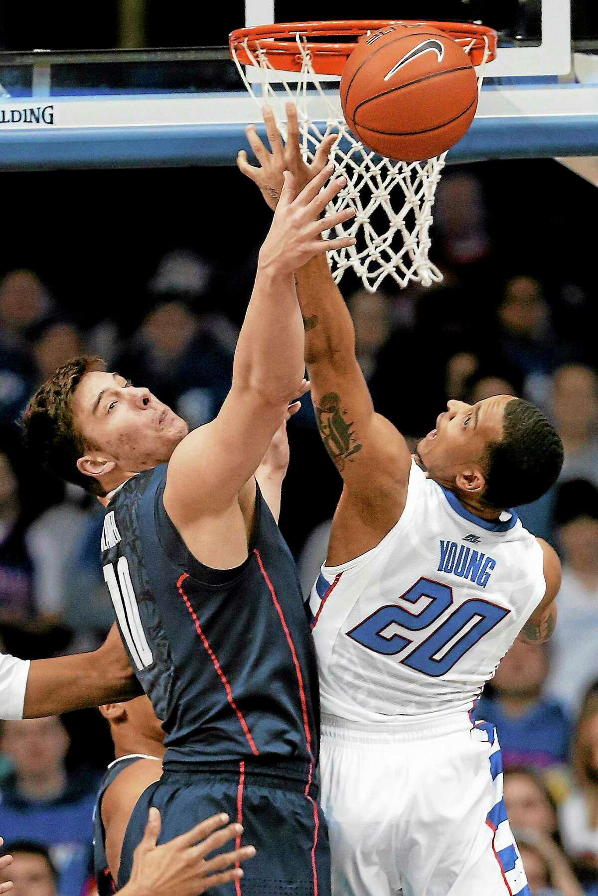 UConn forward Tyler Olander, left, and DePaul guard Brandon Young battle for a rebound during a game last season in Rosemont, Ill.