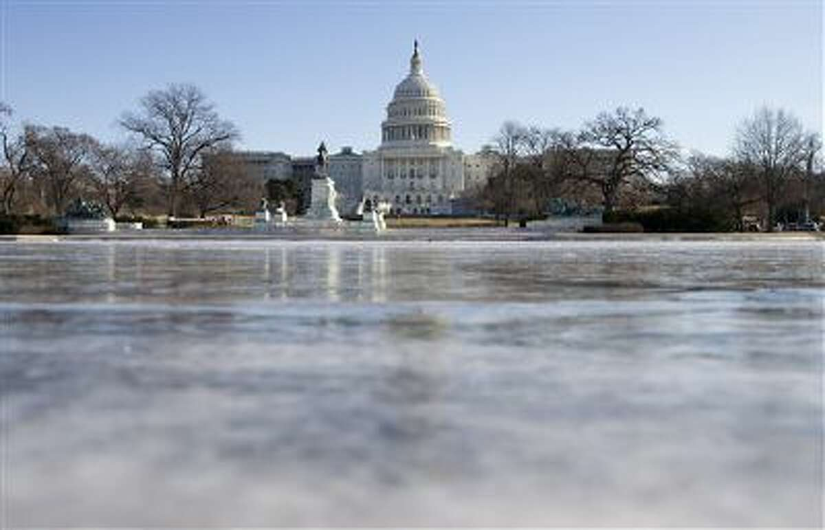 The reflecting pool in front of the U.S. Capitol building is frozen over on Tuesday.