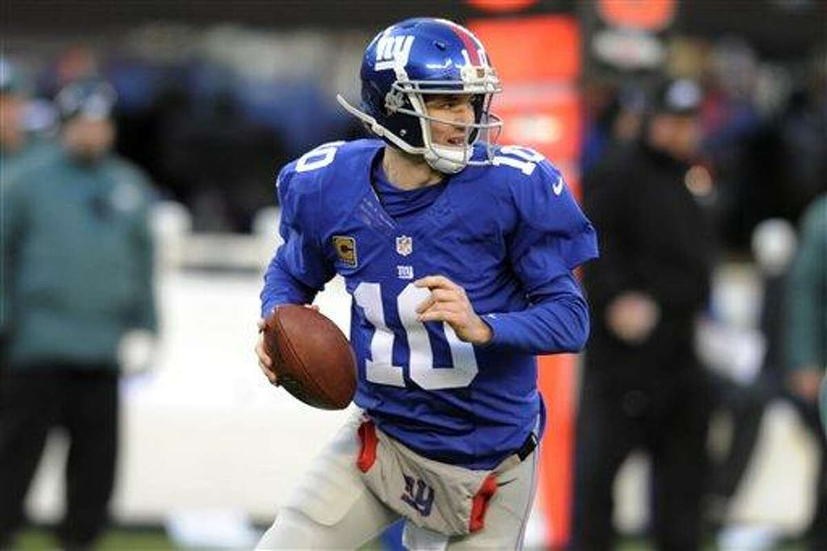 New York Giants' Eli Manning looks to pass during the first half of an NFL football game against the Philadelphia Eagles Sunday, Dec. 30, 2012 in East Rutherford, N.J. (AP Photo/Bill Kostroun)