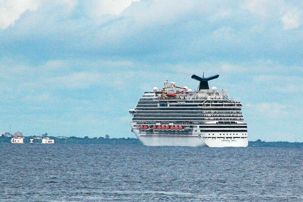 The cruise ship Carnival Magic passes near Cozumel , Mexico, in this Friday, Oct. 17, 2014 photo. The Coast Guard retrieved a blood sample from a Dallas health care worker who is aboard a cruise ship and being monitored for signs of Ebola.