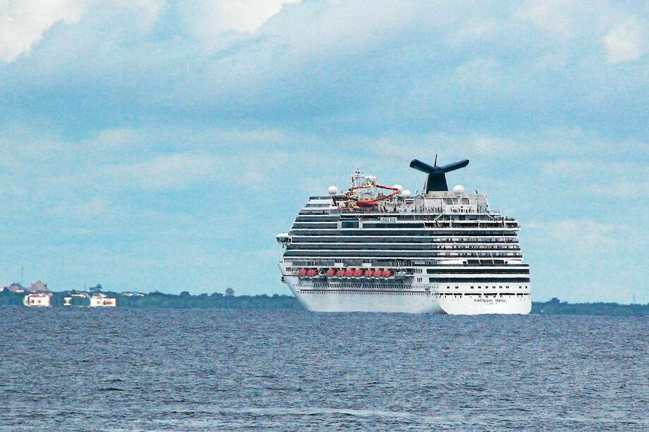 The cruise ship Carnival Magic passes near Cozumel , Mexico, in this Friday, Oct. 17, 2014 photo. The Coast Guard retrieved a blood sample from a Dallas health care worker who is aboard a cruise ship and being monitored for signs of Ebola. Photo: AP Photo/Angel Castellanos, File  / AP