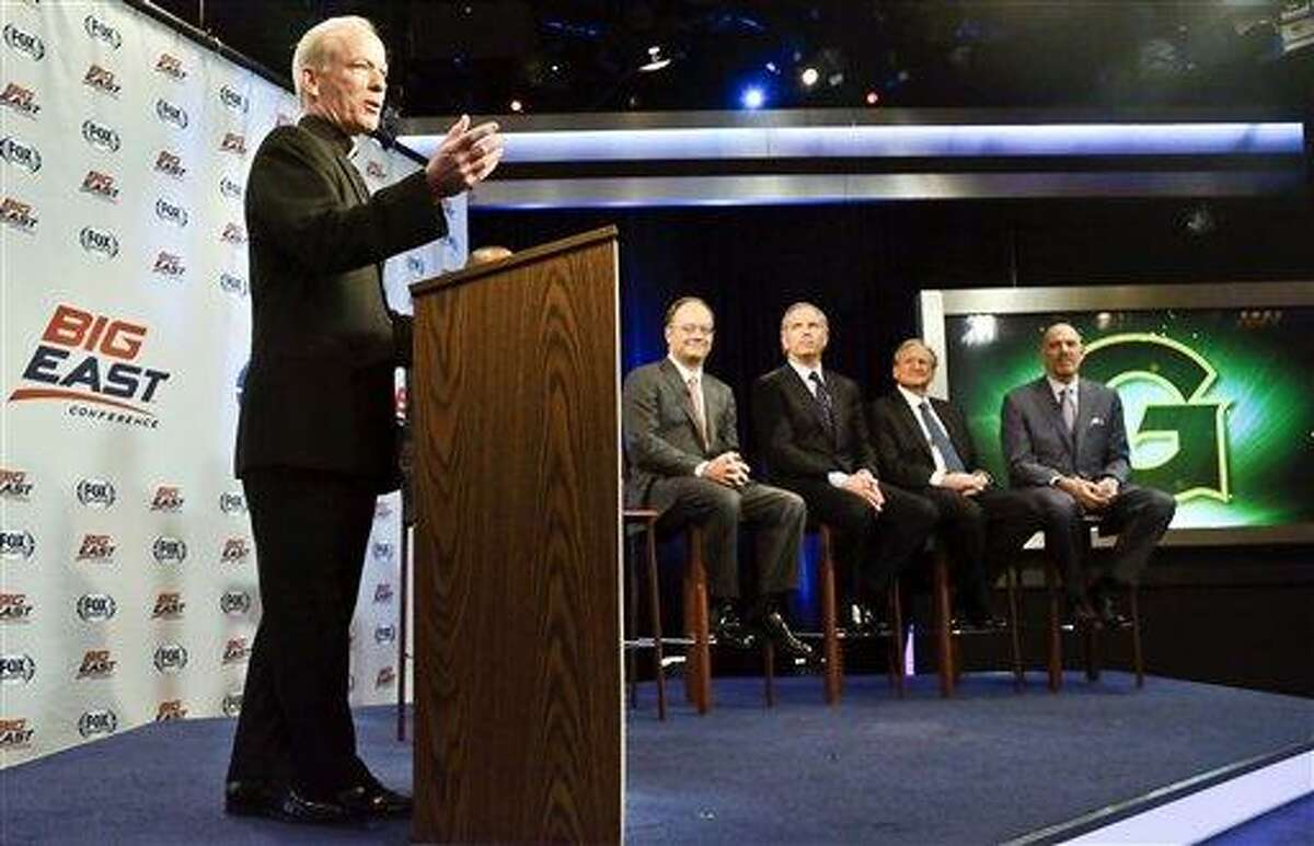 Providence President Rev. Brian Shanley, far left, Georgetown President John DeGioia, second from left, FOX Sports President and COO, Randy Freer, center, FOX Sports V.P. Larry Jones, second from right, and Madison Square Garden Executive Vice President Joel Fisher, far right, appear during a news conference on Wednesday, March 20, 2013 in New York. Big East Conference schools gathered in New York to announce developments helping to shape the new NCAA college basketball focused conference. (AP Photo/Bebeto Matthews)