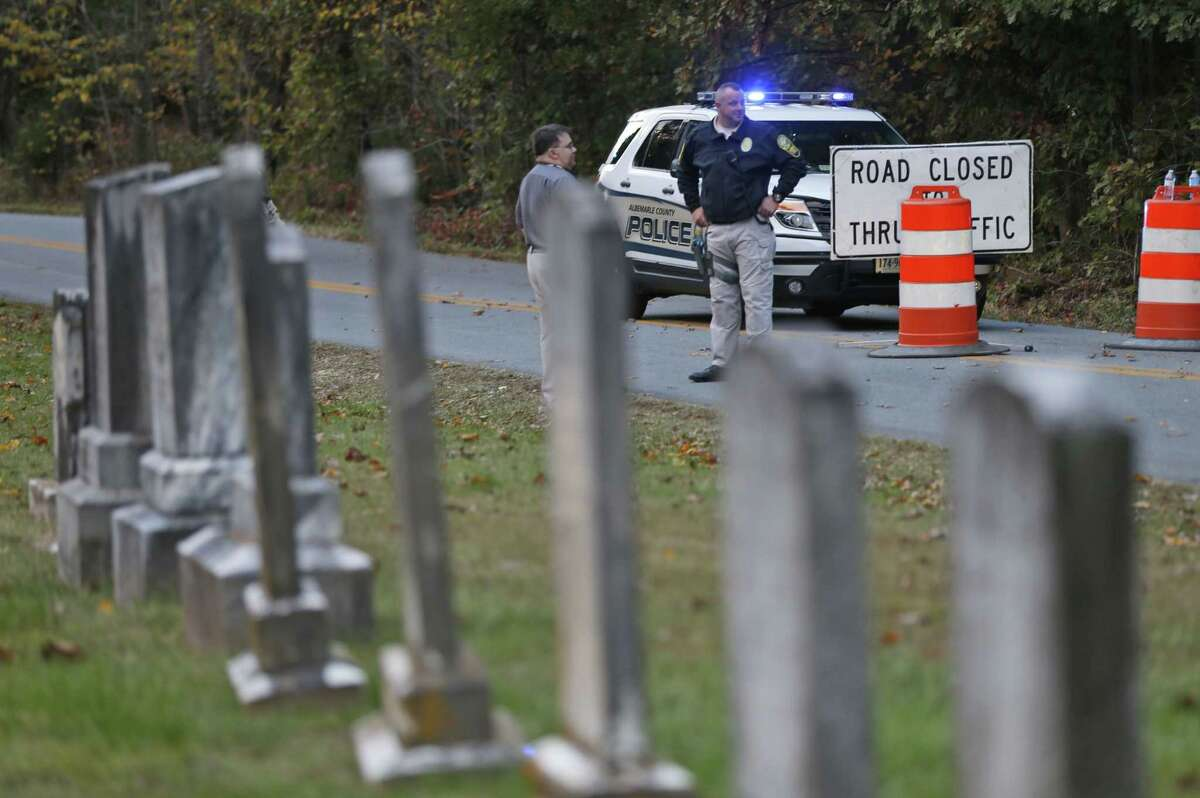 Police block the road leading to the scene of a death investigation in connection with the disappearance of University of Virginia student Hanna Graham in Albermarle County, Va. on Oct. 18, 2014.