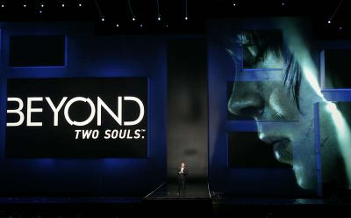 """Jack Tretton, President and CEO of Sony Computer Entertainment America, introduces the game """"Beyond: Two Souls"""" featuring Ellen Page at the Sony Electronic Entertainment Expo (E3) news conference in Los Angeles, June 4, 2012."""
