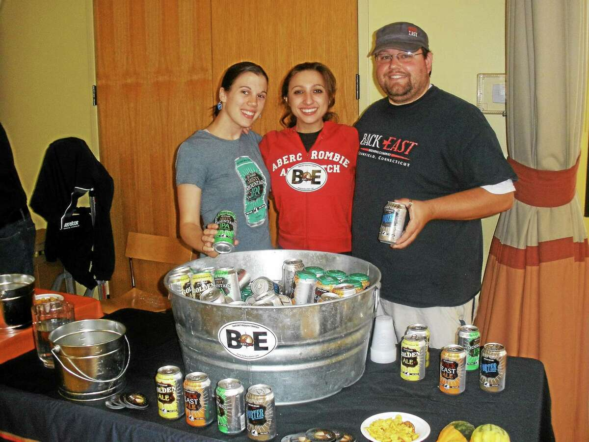 Dozens converged on the Litchfield Community Center Saturday to enjoy the fruits of local vintners and beer makers at the eighth annual Harvest Bounty Wine and Brew Fest benefit.