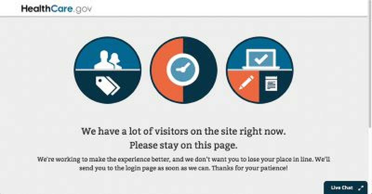 In this screen grab image, the page asks visitors to stay on during the log in process of the Health Care Marketplace website Wednesday, Oct. 2, 2013.