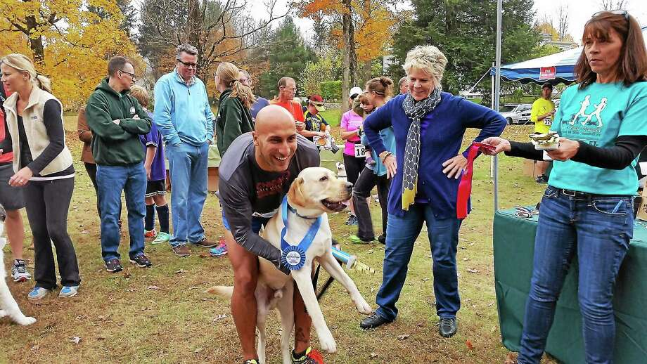 """Saturday's Run & Wag 5K run in Cornwall attracted both serious career runners and casual joggers and walkers. """"It's the first-ever Connecticut doggie-cup championship in the region,"""" said Cohn, executive director of The Little Guild of St. Francis animal shelter. Photo: N.F. Ambery — Special To The Register Citizen"""