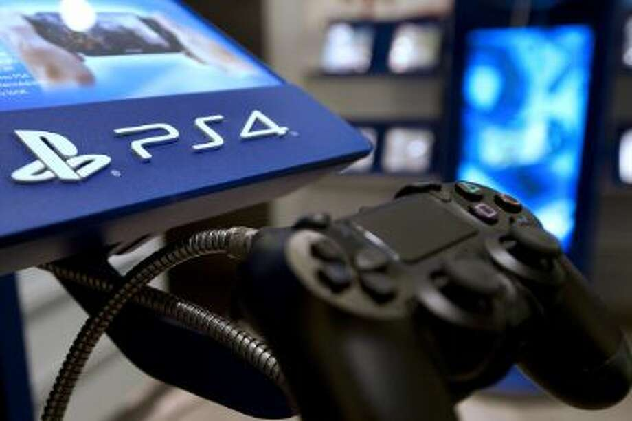 This Nov. 29, 2013, picture taken in a Parisian store shows the joystick of the new Sony Playstation 4 video game console. Photo: AFP/Getty Images / 2013 AFP