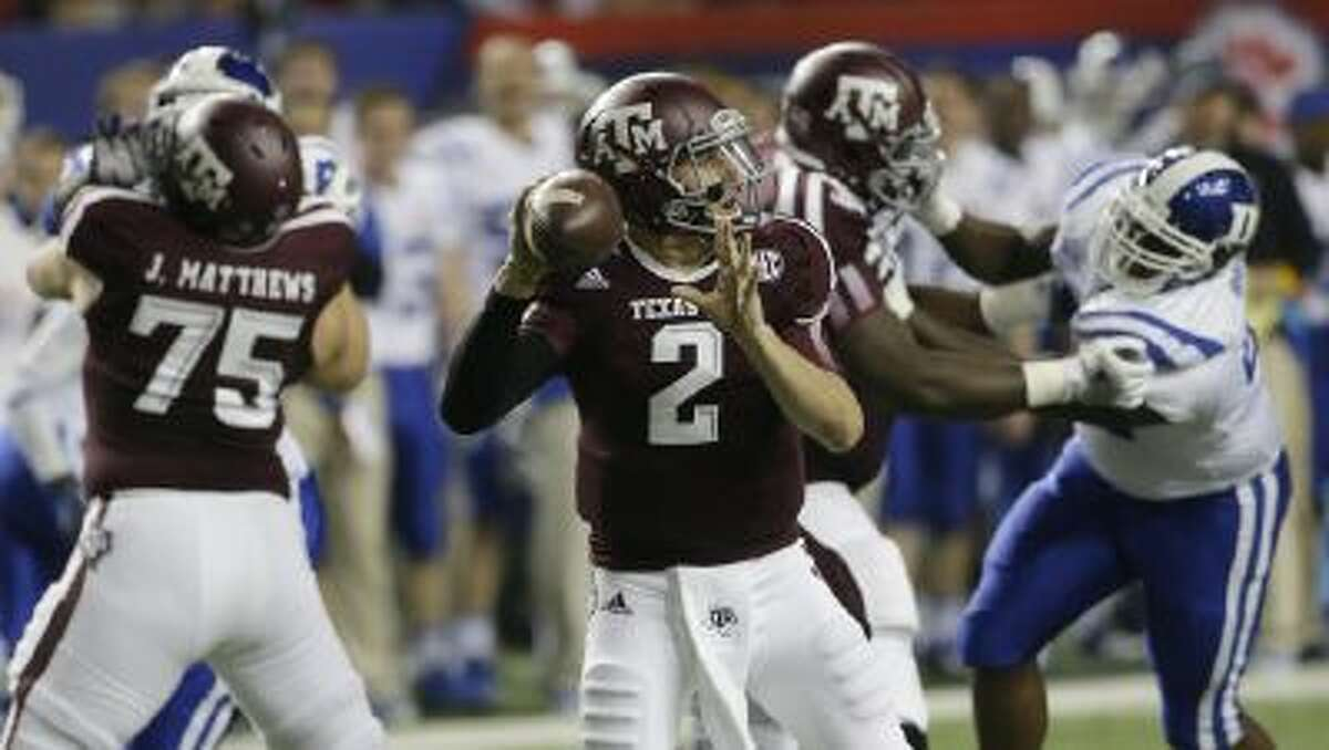 Texas A&M quarterback Johnny Manziel (2) looks for a receiver in the first half of the Chick-fil-A Bowl NCAA college football game against Duke Tuesday, Dec. 31, 2013, in Atlanta.