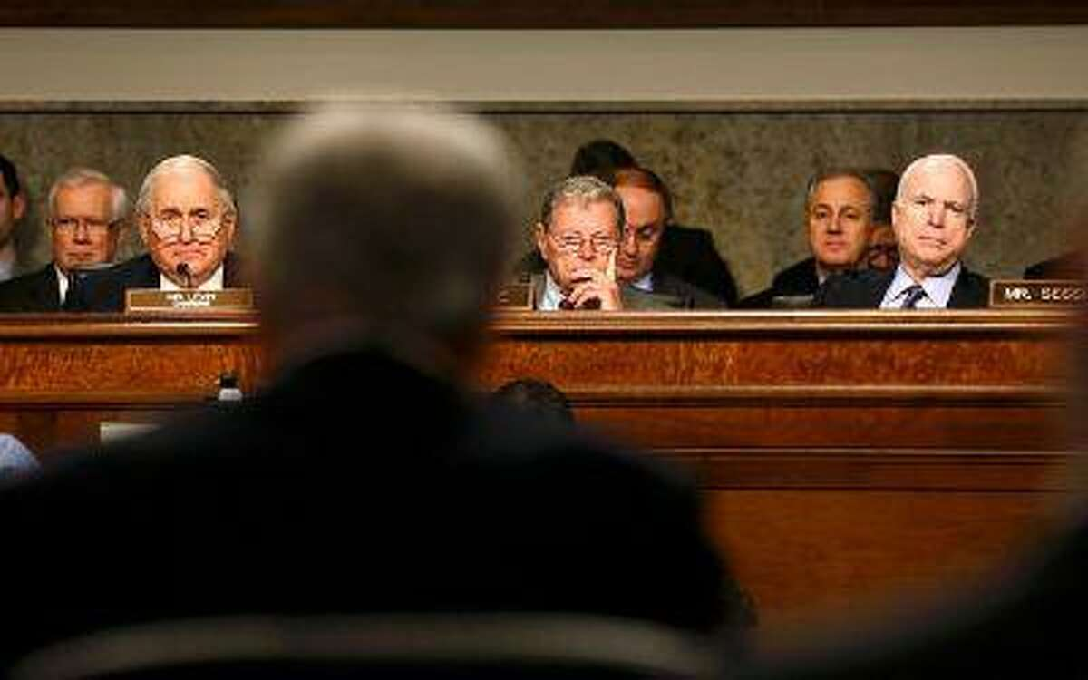 From left, U.S. Senators Carl Levin (D-Mich.), James Inhofe (R-Okla.) and John McCain (R-Ariz.) listen as former senator Chuck Hagel (foreground) testifies Jan. 31 during a Senate Armed Services Committee hearing on Hagel's nomination to be Defense secretary, on Capitol Hill in Washington.