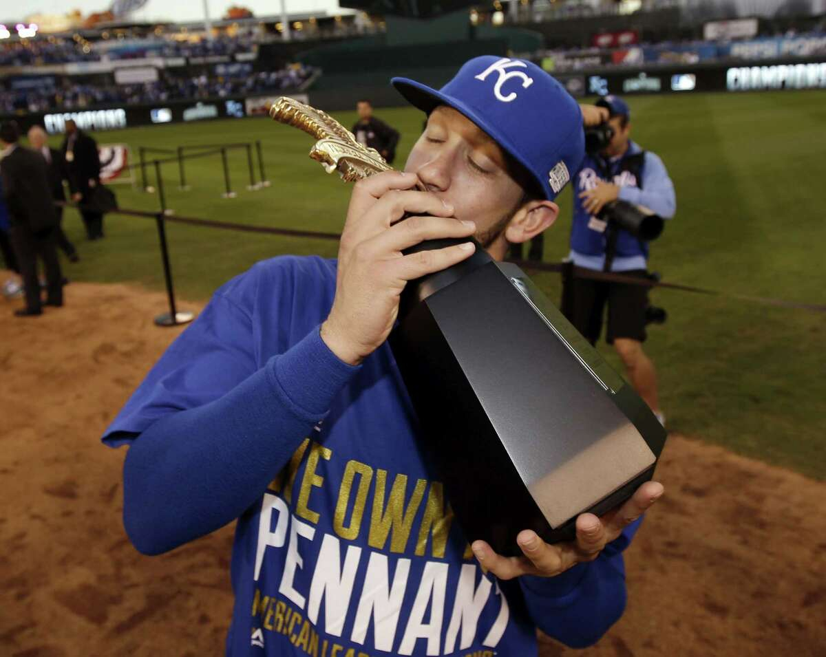 Starting pitcher James Shields kisses the trophy after the Royals defeated the Baltimore Orioles to win the American League championship series on Wednesday in Kansas City, Mo.