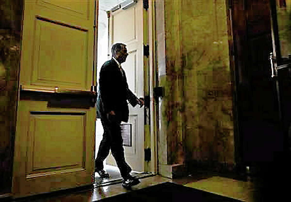 House Speaker John Boehner of Ohio arrives on Capitol Hill in Washington, Friday, Oct. 11, 2013. President Barack Obama and Republicans in the House of Representatives are exploring whether they can end a budget standoff that has triggered a partial government shutdown and put Washington on the verge of an economy-jarring federal default. (AP Photo/ Evan Vucci)