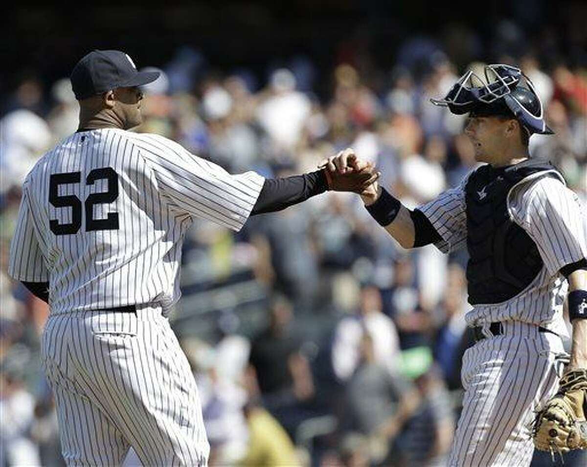 New York Yankees catcher Chris Stewart, right, congratulates starting pitcher CC Sabathia (52) who pitched a complete game as they defeated the Indians 6-4 in a baseball game at Yankee Stadium in New York, Wednesday, June 5, 2013. (AP Photo/Kathy Willens)